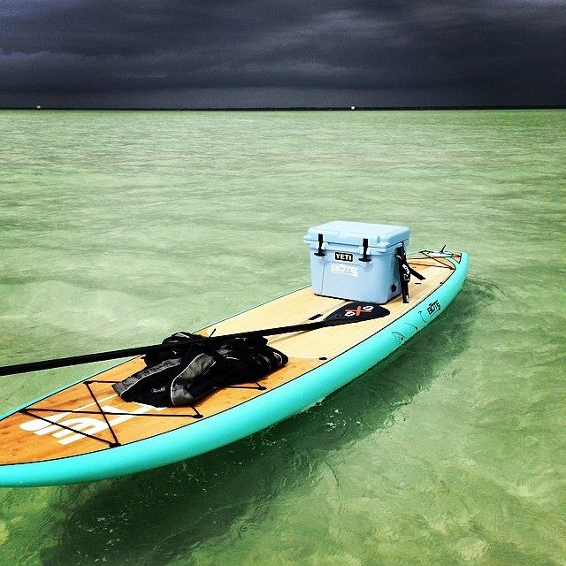 roto-molded cooler on a paddle board