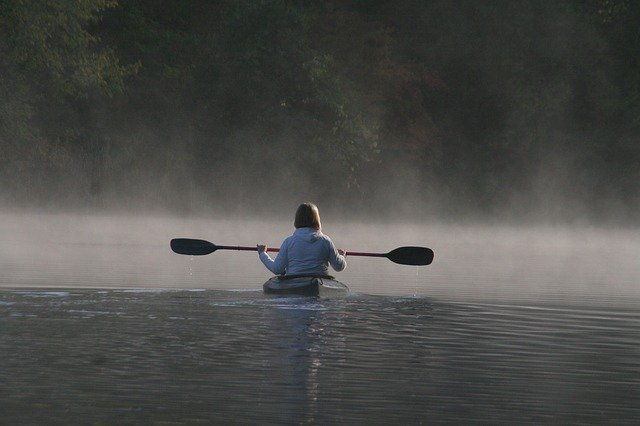 paddling in a sit-in kayak